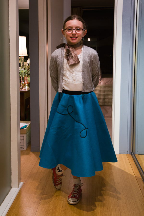Emma attended a Girl Scout sock hop looking quite dashing in her poodle skirt and heels.